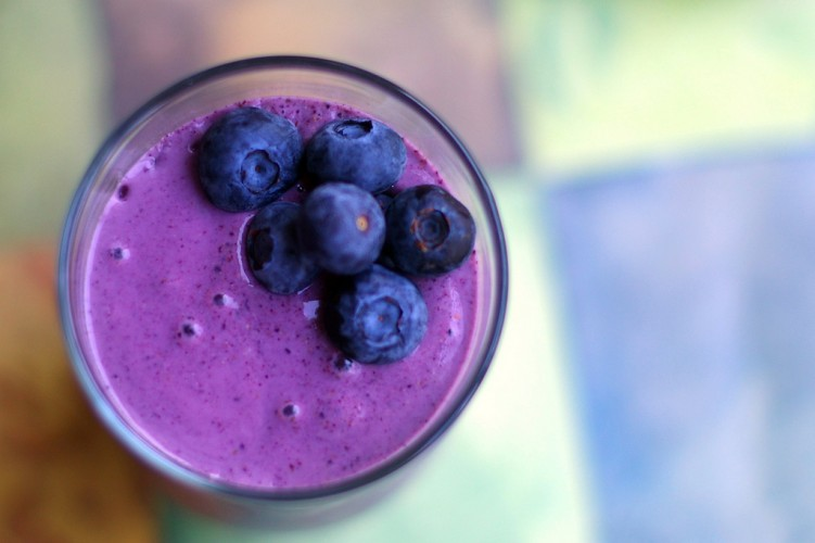 Blueberry smoothie with blueberries on top.